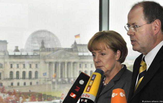 DW: Η Γερμανία κάνει ό,τι απαγορεύει στους άλλους – Πώς έσωσε από χρεοκοπία τις τράπεζες της