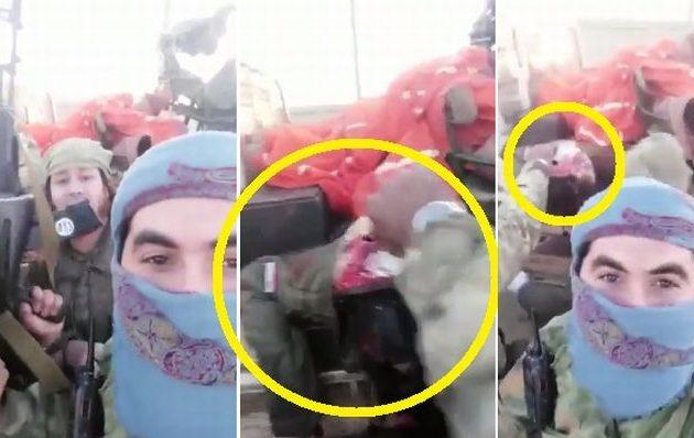 Τζιχαντιστές επιδεικνύουν τον Σύρο πιλότο που σκότωσαν αφού κατέρριψαν το μαχητικό του